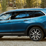 2020 Honda Pilot parked at lakeside with man and boy loading cargo