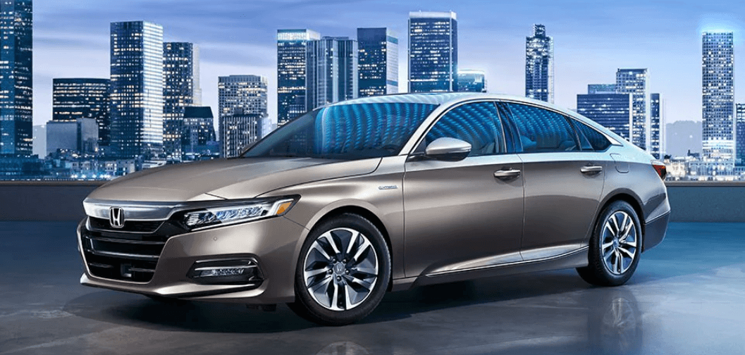 2020 Honda Accord Hybrid Touring trim level in front of skyline