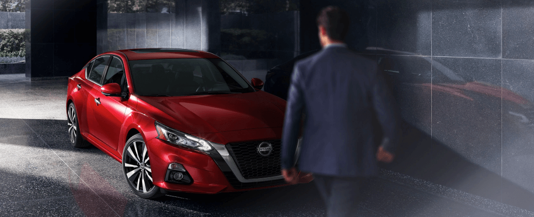 2020 Nissan Altima in garage with man nearby