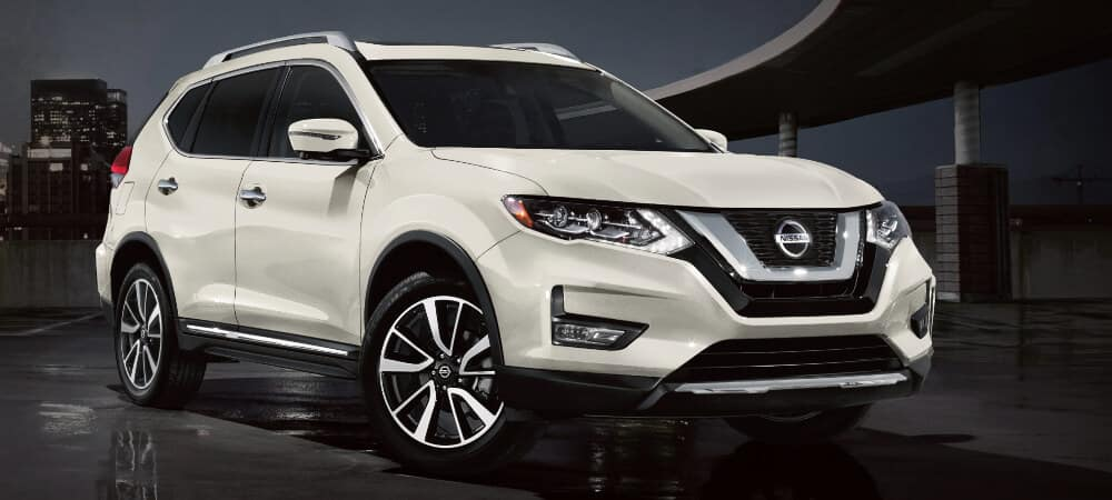 Side view of a white 2020 Nissan Rogue