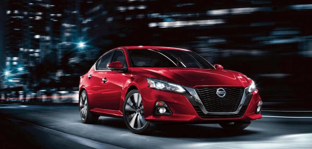2020 Nissan Altima red car driving in city