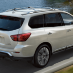 2020 Nissan Pathfinder towing trailer on highway