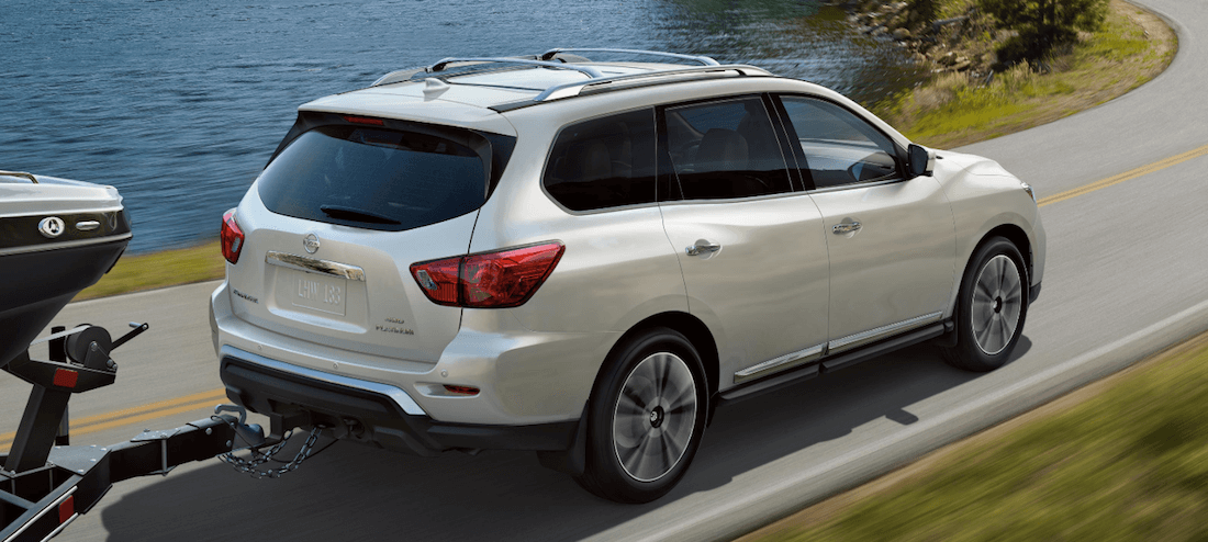 2020 Nissan Pathfinder towing trailer on highway