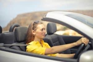 woman-in-yellow-shirt-driving-in-car