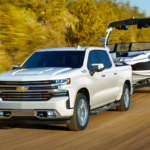 2020 chevrolet silverado 1500 white towing white boat