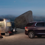 2020 chevy traverse dark purple parked outside with camper
