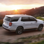 2021 chevy tahoe white exterior driving down scenic road