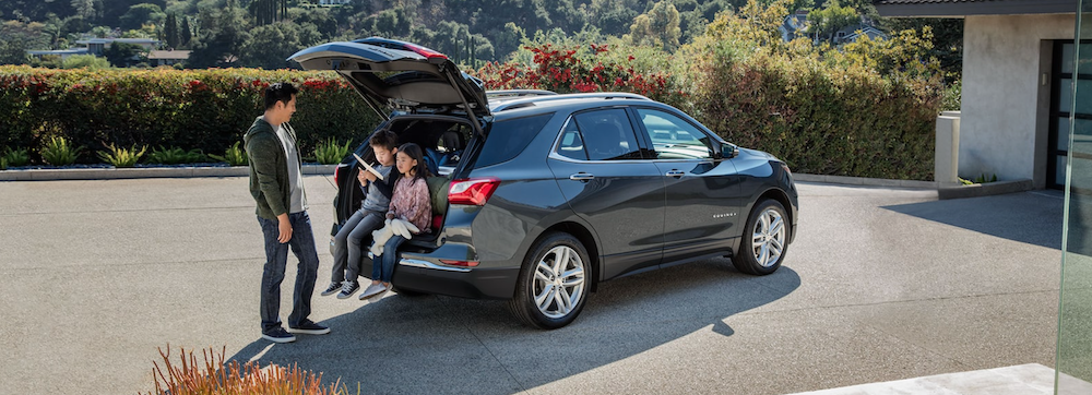 2021 chevy equinox silver exterior with family