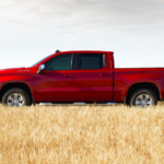 2020 chevrolet silverado 1500 red exterior side parked in field