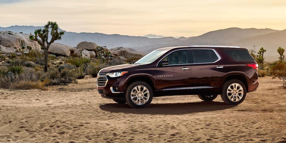 2020 chevrolet traverse dark red exterior parked in desert