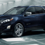 2020 chevy equinox dark blue exterior parked inside