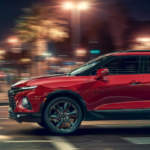 2021 chevy blazer red exterior driving down road