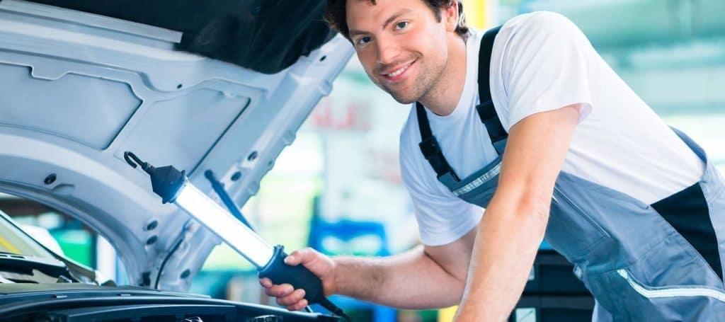 Mechanic Looking Under Hood
