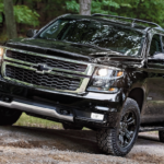 2020 chevy tahoe black exterior driving down dirt road