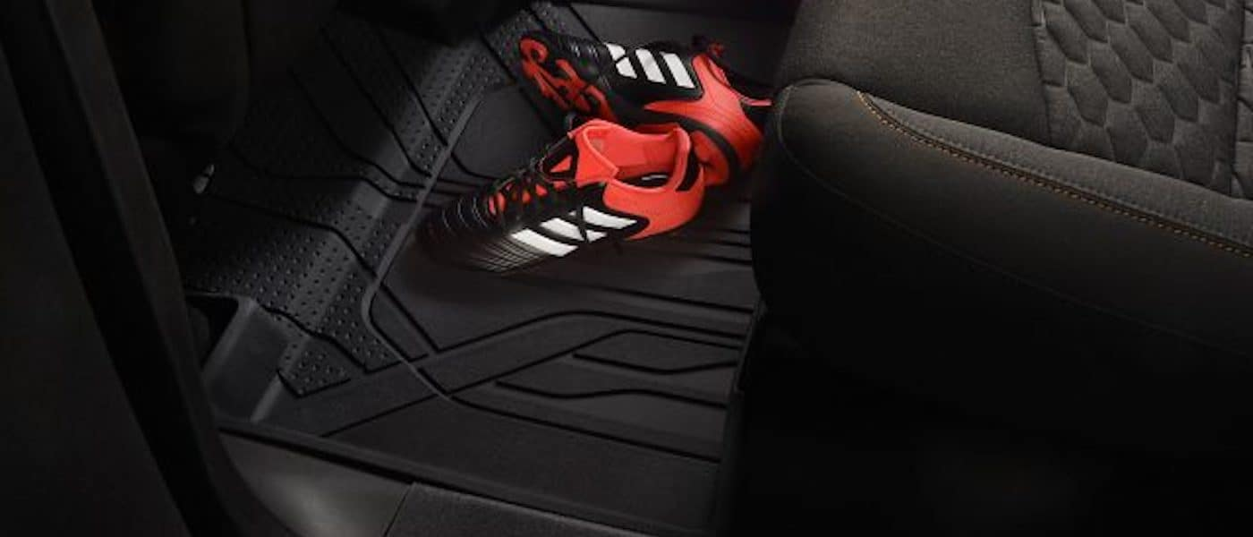 2021 chevy equinox interior floor liners close up with soccer cleats in frame