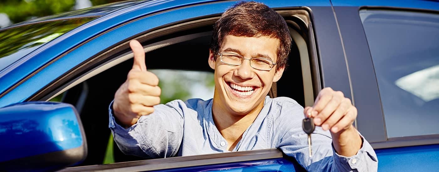 Young man buying a car