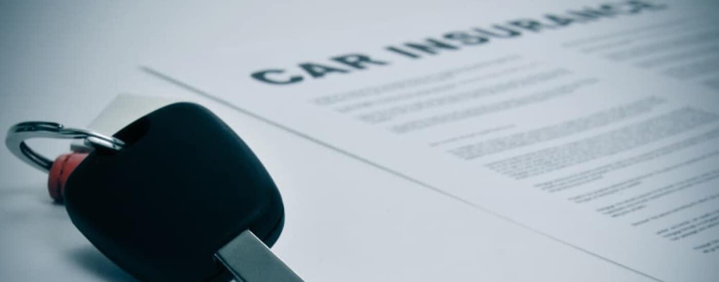 Car insurance paperwork with car key
