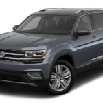A Volkswagen Atlas SUV in a navy blue color against a white background.
