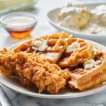 fried chicken and waffles breakfast with maple syrup