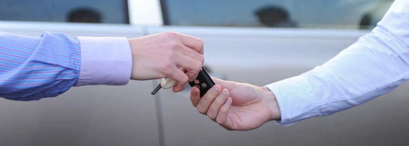 handing key over at a dealership