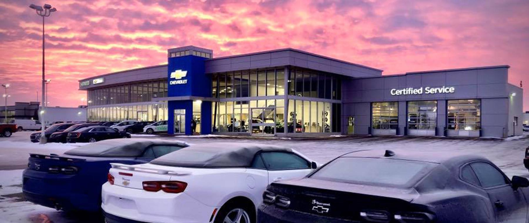 Sunrise behind Sherwood Chevrolet building