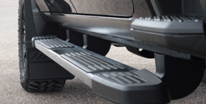 Close up of running board and mud flaps on truck