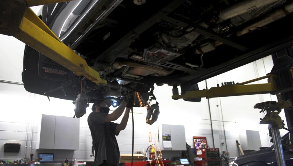Service Technician working under truck