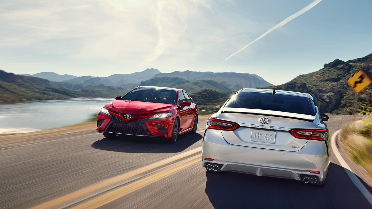 2019 Toyota Camry vehicles driving down road front and rear profile