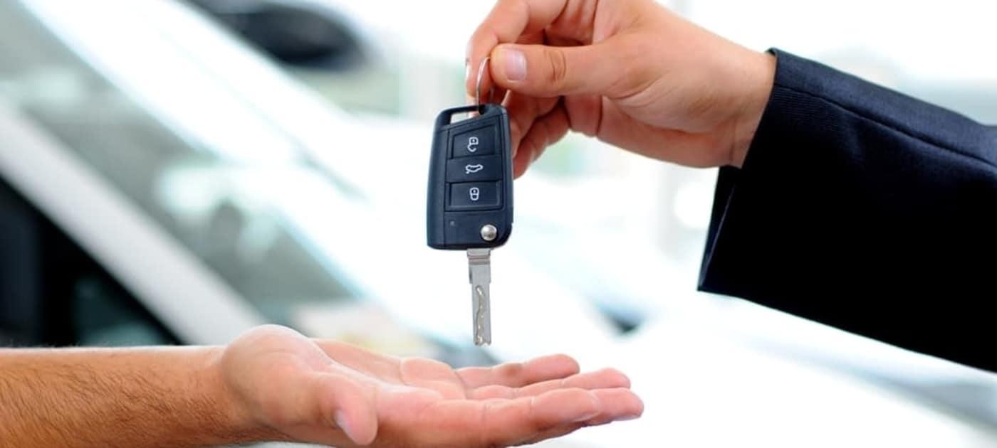 car-salesman-passing-key